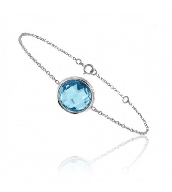 Bracelet chaine Or blanc750/00 et topaze bleue taille ronde