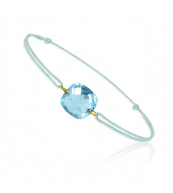 Bracelet cordon Or jaune 750/00 et topaze bleue taille coussin