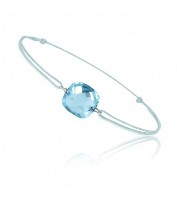 Bracelet cordon Or blanc 750/00 et topaze bleue taille coussin