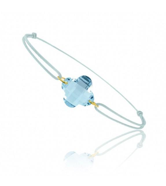 Bracelet cordon Or jaune 750/00 et topaze bleue taille fleur