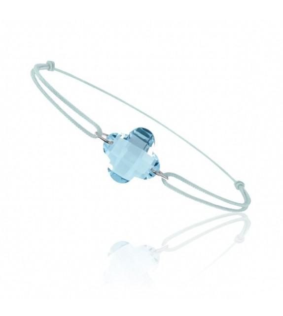 Bracelet cordon Or blanc 750/00 et topaze bleue taille fleur