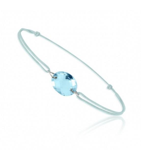 Bracelet cordon Or blanc 750/00 et topaze bleue taille ovale