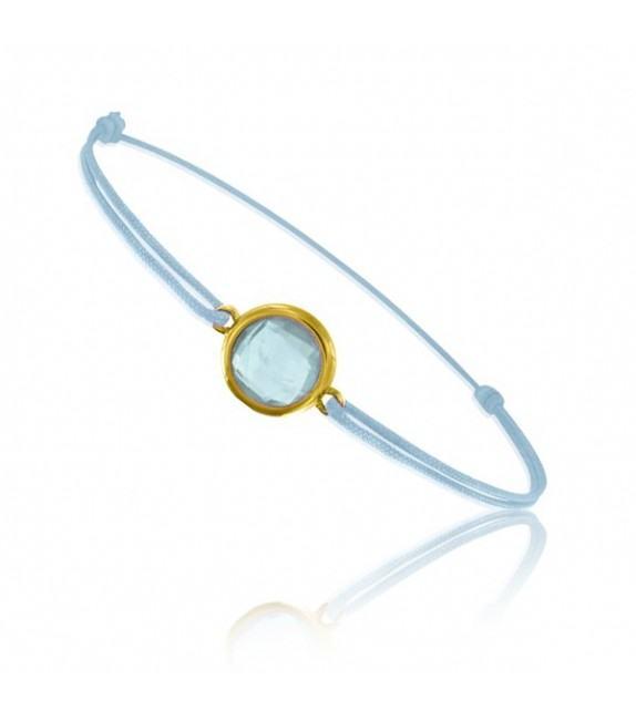 Bracelet cordon Or jaune 750/00 et topaze bleue taille ronde