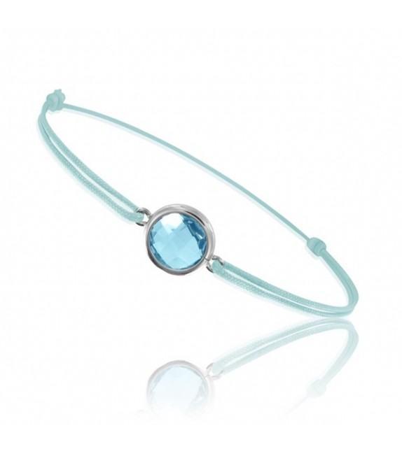 Bracelet cordon Or blanc 750/00 et topaze bleue taille ronde