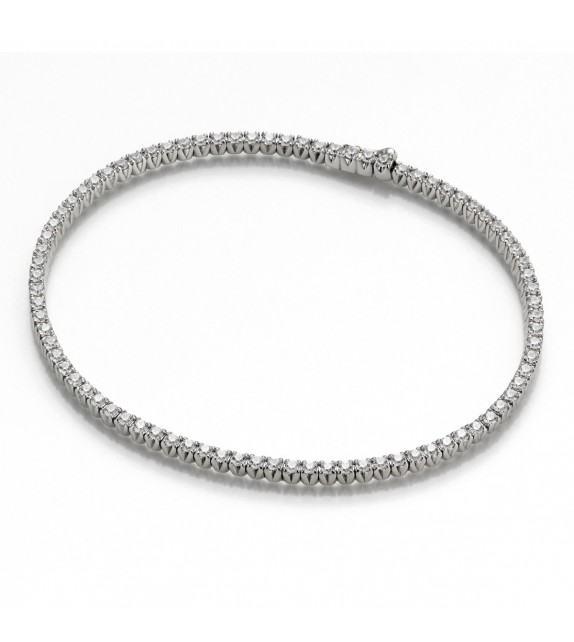 Bracelet rivière 4 griffes Or blanc 750/00 et diamants